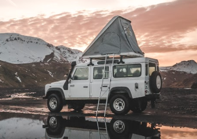 Land Rover Defender w/Roof top tent